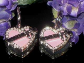 rare JUICY COUTURE SILVER PLATED HEART PINK ENAMEL RS EARRINGS.