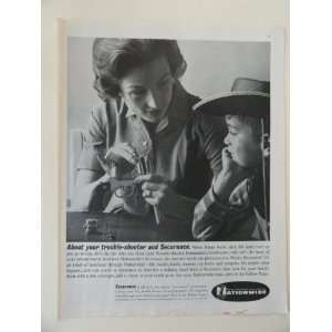 Nationwide Insurance. Vintage 60s full page print ad. (mom fixing gun