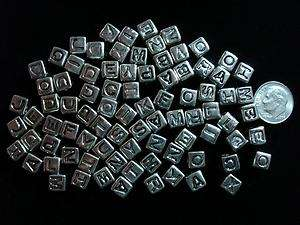 85 Pcs Silver tone alphabet letter cube beads. Silver colored plastic