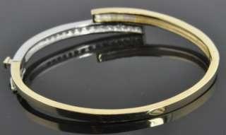 Two Tone 14K Gold .60 CT Diamond Channel Polished Oval Hinged Bangle