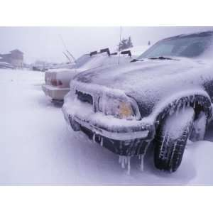 Blizzard Conditions at Ski Resort, Drifts and Ice on Cars, California